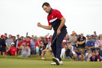 Team USA's Patrick Cantlay makes a putt on the 15th hole during a Ryder Cup singles match at the Whistling Straits Golf Course Sunday, Sept. 26, 2021, in Sheboygan, Wis. (AP Photo/Charlie Neibergall)