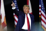 President Donald Trump gestures to supporters after speaking at a campaign rally in Pensacola, Fla., Friday, Oct. 23, 2020. (AP Photo/Gerald Herbert)