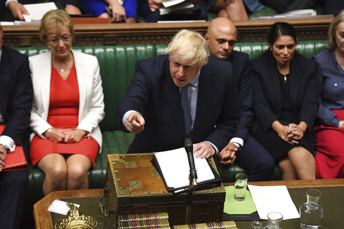 """In this handout photo provided by the House of Commons, Britain's Prime Minister Boris Johnson speaks in Parliament in London, Wednesday, Sept. 25, 2019. An unrepentant Prime Minister Boris Johnson brushed off cries of """"Resign!"""" and dared the political opposition to try to topple him Wednesday at a raucous session of Parliament, a day after Britain's highest court ruled he acted illegally in suspending the body ahead of the Brexit deadline. (Jessica Taylor/House of Commons via AP)"""