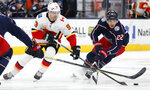 Calgary Flames' Sam Bennett, left, and Columbus Blue Jackets' Sonny Milano chase the puck during the third period of an NHL hockey game Saturday, Nov. 2, 2019, in Columbus, Ohio. (AP Photo/Jay LaPrete)