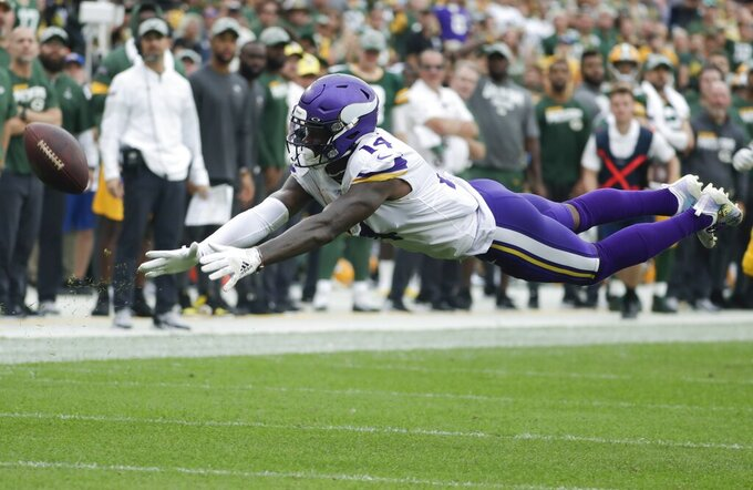 Minnesota Vikings' Stefon Diggs can't catch a long pass during the second half of an NFL football game against the Green Bay Packers Sunday, Sept. 15, 2019, in Green Bay, Wis. (AP Photo/Morry Gash)