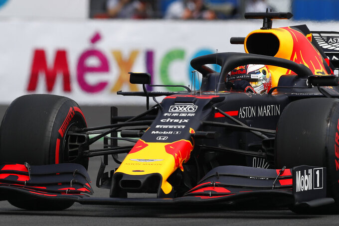 Red Bull driver Max Verstappen, of the Netherlands, competes in the qualifying session for the Formula One Mexico Grand Prix auto race at the Hermanos Rodriguez racetrack in Mexico City, Saturday, Oct. 26, 2019. (AP Photo/Rebecca Blackwell)