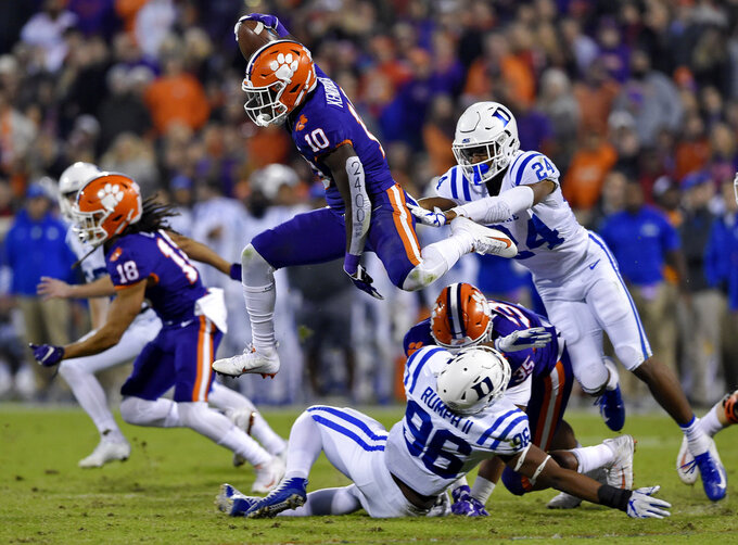 Clemson's Derion Kendrick (10) hurdles Duke's Chris Rumph ll (96) on a kickoff return as Jarrett Garner reaches for him during the first half of an NCAA college football game Saturday, Nov. 17, 2018, in Clemson, S.C. (AP Photo/Richard Shiro)