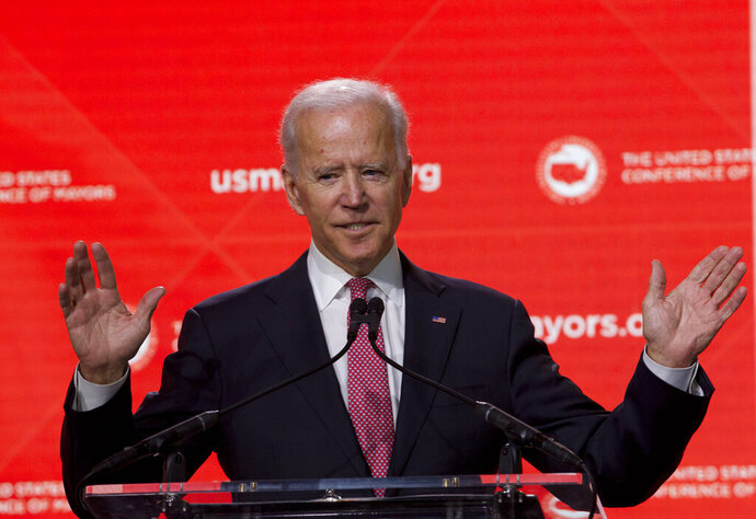 """FILE - In this Jan. 24, 2019, file photo, Former Vice President Joe Biden speaks during the U.S. Conference of Mayors Annual Winter Meeting in Washington. Democratic presidential candidates are touting their support for """"Medicare-for-all,"""" higher taxes on the wealthy and a war on climate change. But foreign policy is largely taking a back seat. Biden is seizing on that opening to position himself as the global policy expert if he decides to run for president. (AP Photo/Jose Luis Magana, File)"""