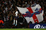 England's Marcus Rashford celebrates after scoring his side's fourth goal during the Euro 2020 group A qualifying soccer match between England and Montenegro at Wembley stadium in London, Thursday, Nov. 14, 2019. (AP Photo/Ian Walton)