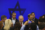 FILE - In this Tuesday, Sept. 10, 2019 file photo, Israeli Prime Minister Benjamin Netanyahu leaves following a press conference in Tel Aviv, Israel. The conservative Likud party has dominated Israeli politics for most of the past 40 years, with Netanyahu as prime minister the past decade. (AP Photo/Oded Balilty, File)