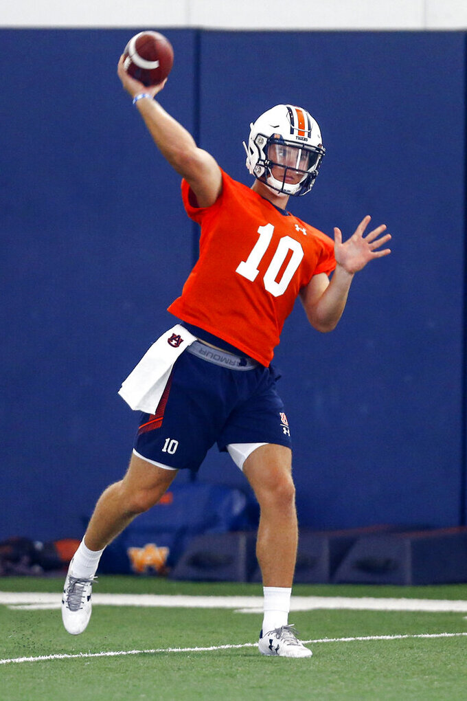Quarterback Bo Nix throws a pass during Auburn's first NCAA college football  practice Friday, Aug. 2, 2019, in Auburn, Ala. (AP Photo/Butch Dill)