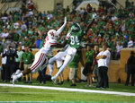 North Texas wide receiver Deonte Simpson (84) jumps for an incomplete pass near the end zone as Houston defensive back Deontay Anderson (2) defends him during the second half of an NCAA college game on Saturday, Sept. 28, 2019, in Denton, Texas.  (Kara Dry/The Denton Record-Chronicle via AP)