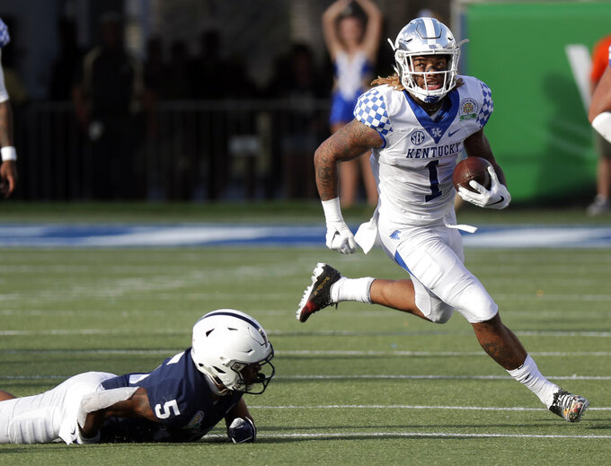 Kentucky wide receiver Lynn Bowden Jr. (1) takes off past Penn State cornerback Tariq Castro-Fields (5) on a 41-yard run during the second half of the Citrus Bowl NCAA college football game, Tuesday, Jan. 1, 2019, in Orlando, Fla. (AP Photo/John Raoux)