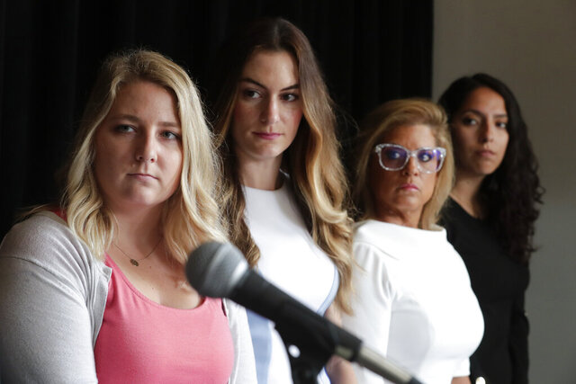 FILE - In this Tuesday, June 18, 2019 file photo, Gabrielle McLemore, left, Niki DaSilva left center, Rep. Mara Candelaria Reardon, right center, and Samantha Lozano listen as their attorney announces a lawsuit against Indiana Attorney General Curtis Hill and the State of Indiana during a press conference in Indianapolis Tuesday, June 18, 2019, on behalf of four women who accused the attorney general of drunkenly groping them at a party. The four women have renewed their court challenges against him. The new lawsuit filed by Democratic state Rep. Mara Candelaria Reardon of Munster and three female legislative staffers seeks unspecified monetary damages from Hill and his retraction of defamatory statements. (AP Photo/Michael Conroy, File)
