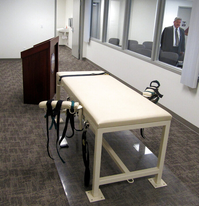 FILE - This Oct. 20, 2011, file photo, shows the execution chamber at the Idaho Maximum Security Institution as Security Institution Warden Randy Blades look on in Boise, Idaho. One of Idaho's death row inmates is nearing the end of his legal appeals, and that could prompt prison officials to prepare for his execution before the end of the year. Gerald Pizzuto, 64, is one of eight people on Idaho's death row. He was sent there in 1986 after his murder conviction for the 1985 beating deaths of Berta and Delbert Herndon at a remote Idaho County cabin. (AP Photo/Jessie L. Bonner, File)