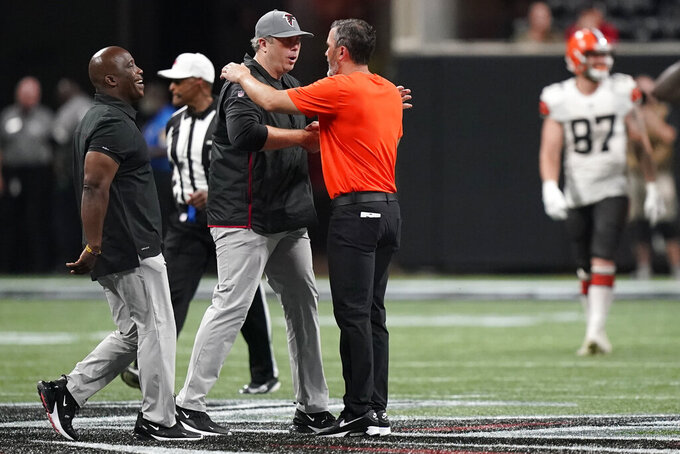 Atlanta Falcons head coach Arthur Smith, left, and Cleveland Browns head coach Kevin Stefanski after the second half of a preseason NFL football game, Sunday, Aug. 29, 2021, in Atlanta. (AP Photo/Brynn Anderson)