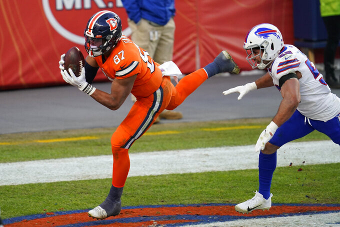 Denver Broncos tight end Noah Fant hauls in a touchdown catch as Buffalo Bills linebacker Andre Smith defends during the first half of an NFL football game Saturday, Dec. 19, 2020, in Denver. (AP Photo/David Zalubowski)