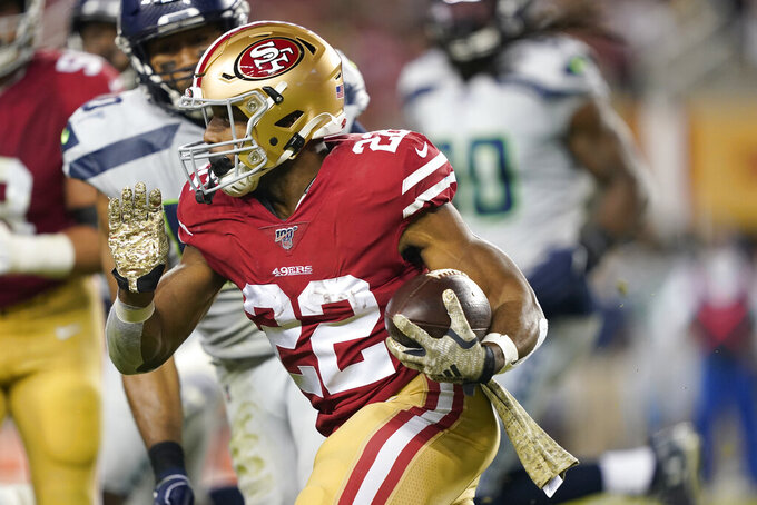 San Francisco 49ers running back Matt Breida (22) runs against the Seattle Seahawks during the first half of an NFL football game in Santa Clara, Calif., Monday, Nov. 11, 2019. (AP Photo/Tony Avelar)
