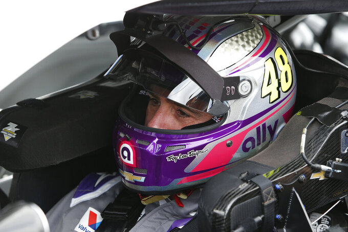 Jimmie Johnson inside his race car prior to the NASCAR Cup Series auto race at Phoenix Raceway, Sunday, Nov. 8, 2020, in Avondale, Ariz. (AP Photo/Ralph Freso)