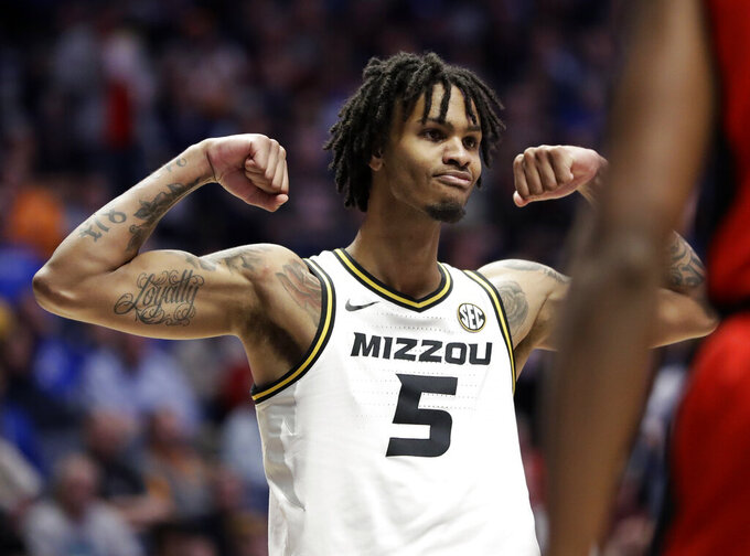 Missouri forward Mitchell Smith celebrates after scoring against Georgia in the second half of an NCAA college basketball game at the Southeastern Conference tournament, Wednesday, March 13, 2019, in Nashville, Tenn. Missouri won 71-61. (AP Photo/Mark Humphrey)