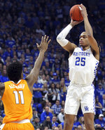 Kentucky's PJ Washington (25) shoots while defended by Tennessee's Kyle Alexander (11) during the first half of an NCAA college basketball game in Lexington, Ky., Saturday, Feb. 16, 2019. (AP Photo/James Crisp)
