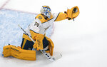 Nashville Predators goalie Juuse Saros (74) makes the save during first-period NHL hockey exhibition game action against the Dallas Stars in Edmonton, Alberta, Thursday, July 30, 2020. (Jason Franson/The Canadian Press via AP)