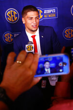 Mississippi quarterback Matt Corral speaks to reporters during the NCAA college football Southeastern Conference Media Days, Tuesday, July 16, 2019, in Hoover, Ala. (AP Photo/Butch Dill)