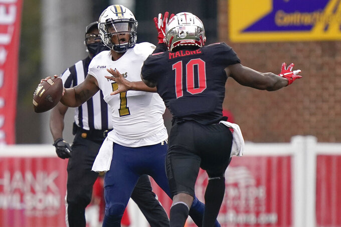 Western Kentucky defensive end DeAngelo Malone (10) pressures Florida International quarterback Kaylan Wiggins during the second half of an NCAA college football game Saturday, Nov. 21, 2020, in Bowling Green, Ky. (AP Photo/Bryan Woolston)