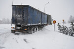 A truck is stuck in the snow in Umeaa, Sweden, Tuesday Jan. 12, 2021. Some thousands of households across northern Sweden and southern Finland are without power Wednesday Jan. 13, 2021, after heavy snowfall and icy temperatures swept across the region. (Erik Abel / TT via AP)