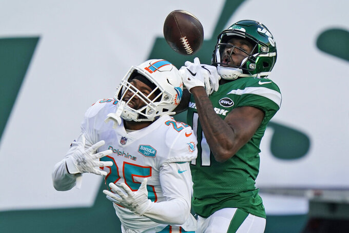 New York Jets' Denzel Mims, right, cannot hold onto the ball in the end zone while Miami Dolphins' Xavien Howard defends during the second half of an NFL football game, Sunday, Nov. 29, 2020, in East Rutherford, N.J. (AP Photo/Corey Sipkin)