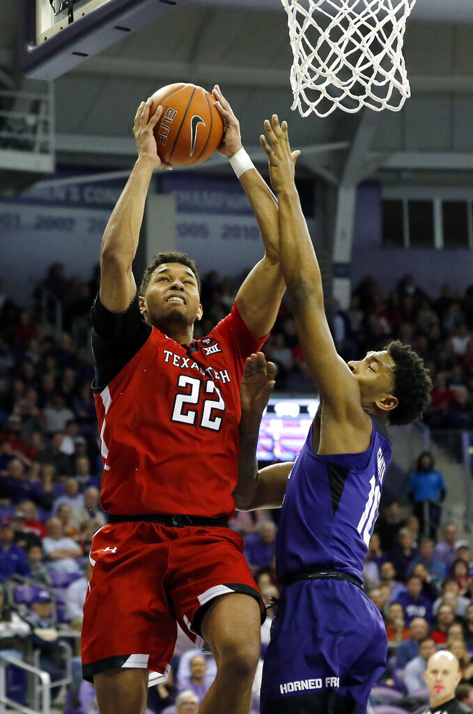 Texas Tech forward TJ Holyfield, left, goes up for the dunk on. Texas Tech forward Tyreek Smith, right, during the first half of an NCAA college basketball game in Fort Worth, Texas, Tuesday, Jan. 21, 2020. (AP Photo/Ray Carlin)