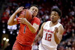 Maryland's Anthony Cowan Jr. (1) tries to control the ball as he drives past Nebraska's Thomas Allen (12) during the first half of an NCAA college basketball game in Lincoln, Neb., Wednesday, Feb. 6, 2019. (AP Photo/Nati Harnik)