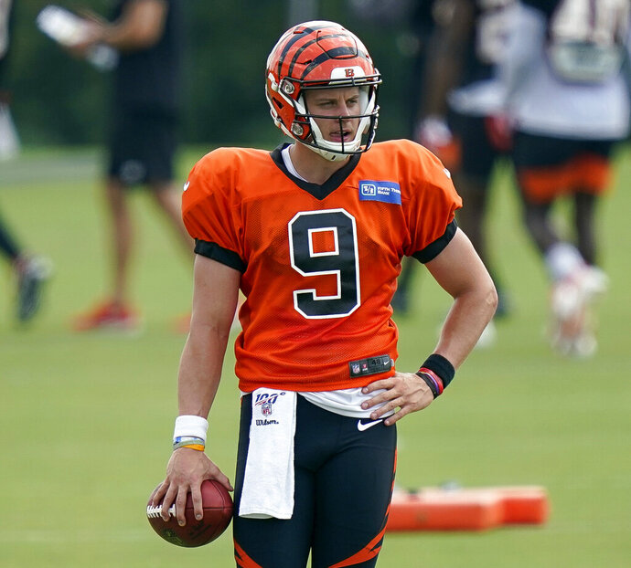 FILE - In this Aug. 26, 2020, file photo, Cincinnati Bengals quarterback Joe Burrow walks on the field during NFL football training camp in Cincinnati. Burrow was picked as one of the Bengals' captains even before he took a snap. (AP Photo/Bryan Woolston, File)