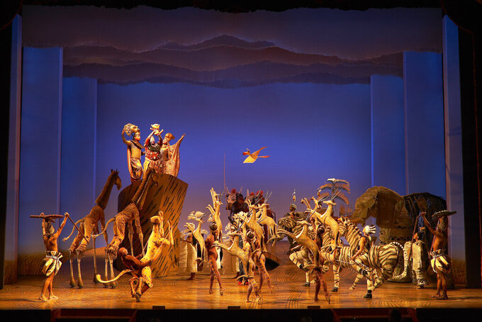 """This image released by Disney Theatrical Productions shows the cast during a performance of """"The Lion King."""" (Disney Theatrical Productions via AP)"""