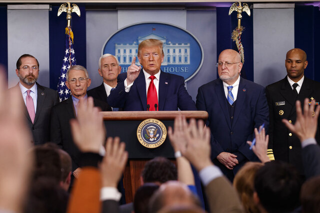 """FILE - In this Feb. 29, 2020, file photo President Donald Trump, center, points as he prepares to answer question after speaking about the coronavirus in the press briefing room at the White House in Washington, as Health and Human Services Secretary Alex Azar, National Institute for Allergy and Infectious Diseases Director Dr. Anthony Fauci, Vice President Mike Pence, Robert Redfield, director of the Centers for Disease Control and Prevention and U.S. Surgeon General Dr. Jerome Adams listen. Public health officials were already warning Americans about the need to prepare for the coronavirus threat in early February when President Donald Trump called it """"deadly stuff"""" in a private conversation that has only now has come to light. (AP Photo/Carolyn Kaster, File)"""