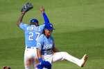 Kansas City Royals shortstop Adalberto Mondesi (27) and second baseman Nicky Lopez, right, celebrate following a baseball game against the Minnesota Twins at Kauffman Stadium in Kansas City, Mo., Sunday, Aug. 9, 2020. (AP Photo/Orlin Wagner)