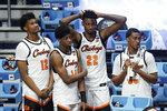 Oklahoma State players watch from the bench during the second half of a men's college basketball game against Oregon State in the second round of the NCAA tournament at Hinkle Fieldhouse in Indianapolis, Monday, March 22, 2021. Oregon State won 80-70. (AP Photo/Paul Sancya)