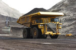 FILE - In this April 4, 2013, file photo, a mining dumper truck hauls coal at Cloud Peak Energy's Spring Creek strip mine near Decker, Mont. Federal courts have delivered a string of rebukes to the Trump administration over what they found were failures to protect the environment and address climate change as it promotes fossil fuel interests and the extraction of natural resources from public lands. (AP Photo/Matthew Brown, File)