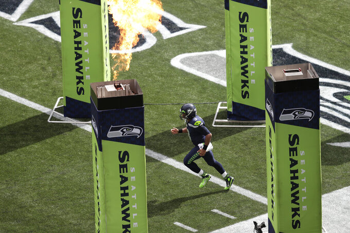 Seattle Seahawks quarterback Russell Wilson runs out of the tunnel during player introductions before an NFL football game against the Cincinnati Bengals, Sunday, Sept. 8, 2019, in Seattle. (AP Photo/Stephen Brashear)