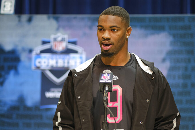 LSU linebacker K'Lavon Chaisson speaks during a press conference at the NFL football scouting combine in Indianapolis, Thursday, Feb. 27, 2020. (AP Photo/AJ Mast)