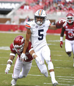 Auburn receiver Anthony Schwartz is knocked out of bounds by Arkansas defender McTelvin Agim during the second half of an NCAA college football game, Saturday, Oct. 19, 2019 in Fayetteville, Ark. (AP Photo/Michael Woods)