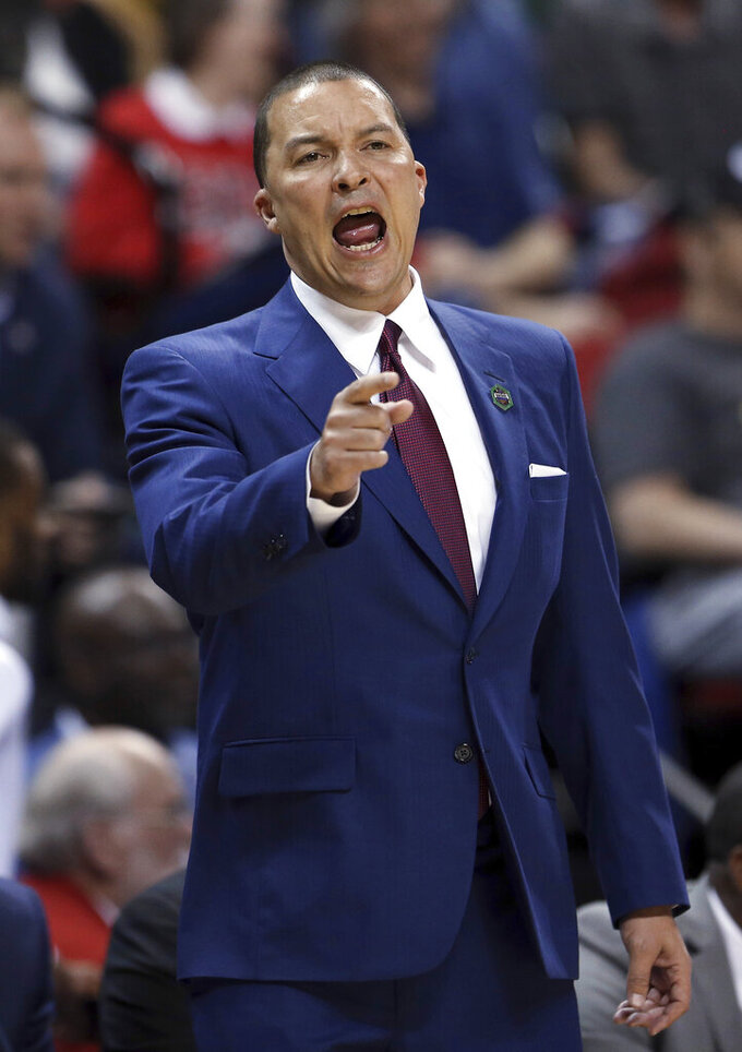 Fresno State head coach Justin Hutson questions a call during the first half of the team's NCAA college basketball game against Utah State in the Mountain West Conference men's tournament Friday, March 15, 2019, in Las Vegas. (AP Photo/Isaac Brekken)