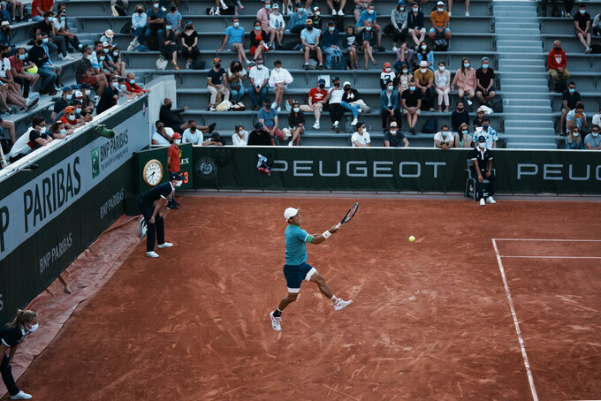 Japan's Kei Nishikori returns the ball to Italy's Alessandro Giannessi during their first round match of the French Open tennis tournament at the Roland Garros stadium Sunday, May 30, 2021 in Paris. (AP Photo/Thibault Camus)