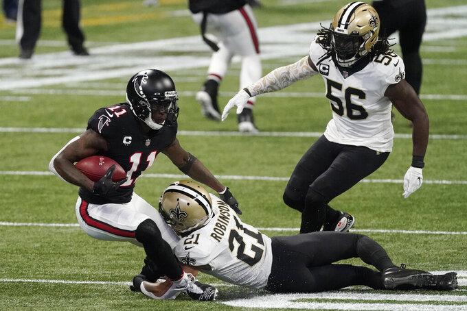 New Orleans Saints cornerback Patrick Robinson (21) stops Atlanta Falcons wide receiver Julio Jones (11) during the first half of an NFL football game, Sunday, Dec. 6, 2020, in Atlanta. (AP Photo/John Bazemore)
