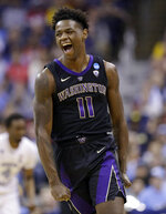 Washington's Nahziah Carter reacts after hitting a three-point shot against North Carolina in the first half during a second round men's college basketball game in the NCAA Tournament in Columbus, Ohio, Sunday, March 24, 2019. (AP Photo/Tony Dejak)
