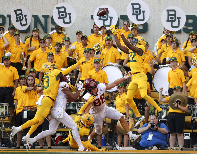 Baylor's JT Woods (22) intercepts a two point conversion intended for Iowa State tight end Charlie Kolar (88) in the second half of an NCAA college football game, Saturday, Sept. 25, 2021, in Waco, Texas. (Jerry Larson/Waco Tribune-Herald via AP)