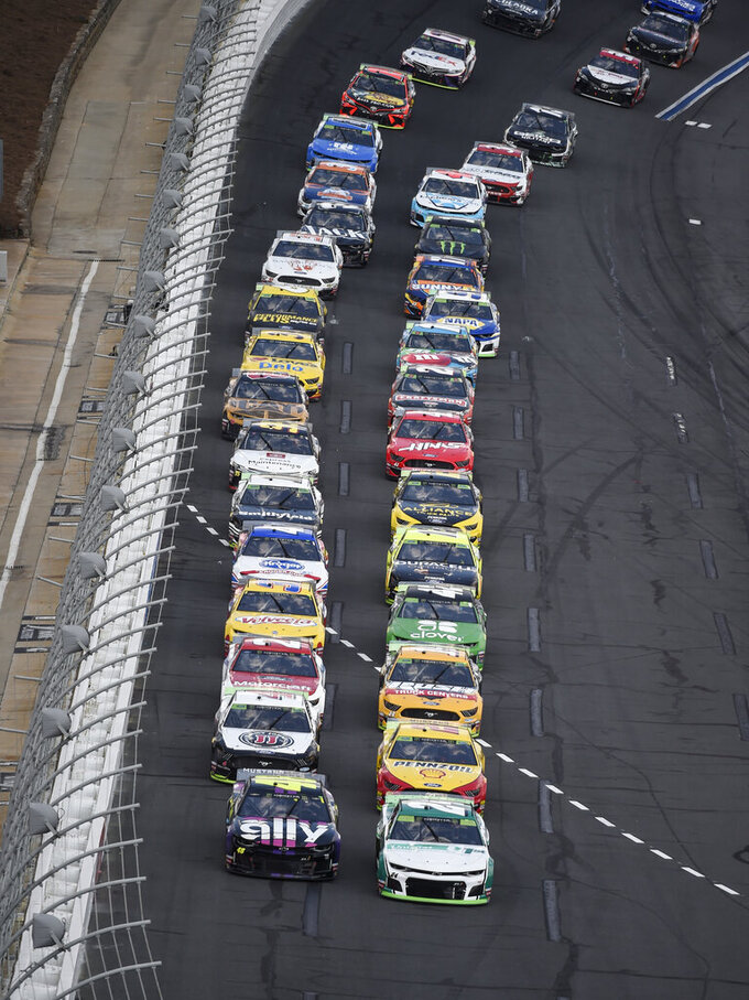 William Byron (24) leads the field to the start of a NASCAR Cup Series auto race at Charlotte Motor Speedway, Sunday, Sept. 29, 2019, in Concord, N.C. (AP Photo/Mike McCarn)