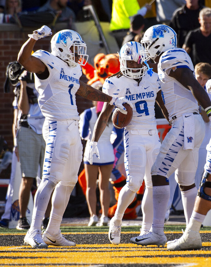Memphis wide receiver Tony Pollard, left, celebrates his touchdown with teammates during the first half of an NCAA college football game against Missouri, Saturday, Oct. 20, 2018, in Columbia, Mo. (AP Photo/L.G. Patterson)