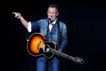 FILE - In this Nov. 5, 2018, file photo, Bruce Springsteen performs at the 12th annual Stand Up For Heroes benefit concert at the Hulu Theater at Madison Square Garden in New York. Springsteen will be among a star-studded guest list for the Rock and Roll Hall of Fame 2020 induction. (Photo by Brad Barket/Invision/AP, File)