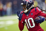 FILE - In this Dec. 8, 2019, file photo, Houston Texans wide receiver DeAndre Hopkins runs for a touchdown against the Denver Broncos after a catch during the second half of an NFL football game in Houston. Arizona Cardinals GM Steve Keim has been widely praised over the past few weeks after adding elite receiver Hopkins in a trade and signing three potential defensive starters. The moves have given Arizona a lot of flexibility for the upcoming draft, eliminating the gaping holes that needed immediate attention. (AP Photo/David J. Phillip, File)