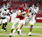 Alabama quarterback Mac Jones (10) runs for a first down and is pursued by Mississippi State linebacker Nathaniel Watson (14) during an NCAA college football game Saturday, Oct. 31, 2020, in Tuscaloosa, Ala. (Gary Cosby Jr./The Tuscaloosa News via AP)