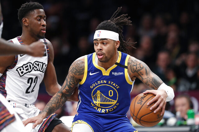 Golden State Warriors guard D'Angelo Russell (0) drives next to Brooklyn Nets guard Caris LeVert (22) during the first half of an NBA basketball game Wednesday, Feb. 5, 2020, in New York. (AP Photo/Kathy Willens)