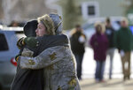 Sarah Rogstad, right, hugs Morgan Rogstad, grade 9, after being reunited at the Tipler Middle school reunification center on Tuesday December 3, 2019, in Oshkosh, Wis. Earlier, police responded to an officer invloved shooting at Oshkosh West High School after an armed student confronted a school resource officer.  (Wm. Glasheen/The Post-Crescent via AP)