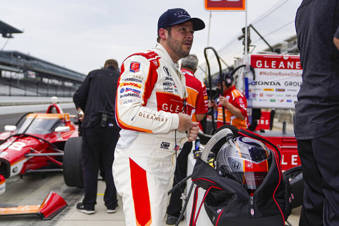 Marco Andretti removes his gear after a session during practice for the Indianapolis 500 auto race at Indianapolis Motor Speedway in Indianapolis, Tuesday, May 18, 2021. (AP Photo/Michael Conroy)
